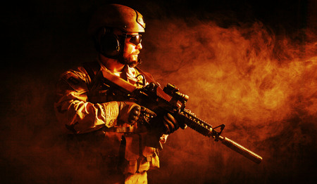 Foto de Bearded special forces soldier on dark background - Imagen libre de derechos