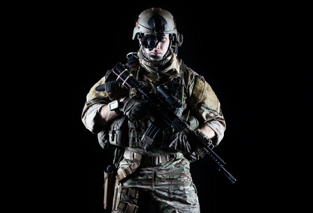 Foto de United States Army ranger with assault rifle on dark background - Imagen libre de derechos