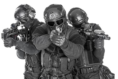 Foto de Spec ops police officers SWAT in black uniform and face mask studio shot - Imagen libre de derechos