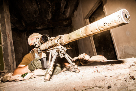 Foto de Navy Seal Sniper with rifle in action - Imagen libre de derechos