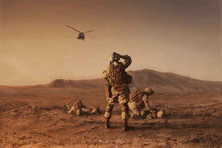 Photo for Squad of US marines waiting for medevac bird - Royalty Free Image
