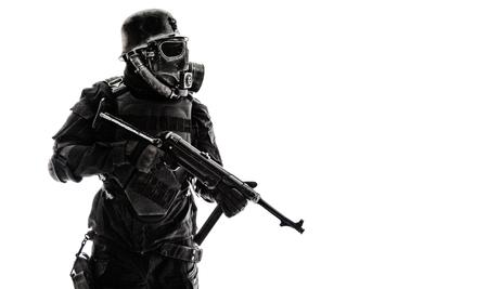 Foto de Futuristic nazi soldier sentinel gas mask and steel helmet with schmeisser handgun isolated on white studio shot standing to attention profile - Imagen libre de derechos