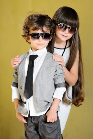 Photo pour portrait of stylish little boy and girl outdoors  - image libre de droit