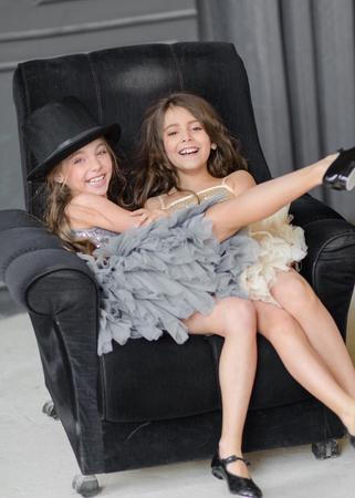 Foto de portrait of two girls of girlfriends on a summer nature - Imagen libre de derechos