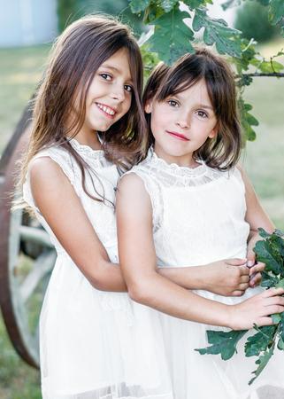Foto de Portrait of two girls in the woods girlfriends - Imagen libre de derechos