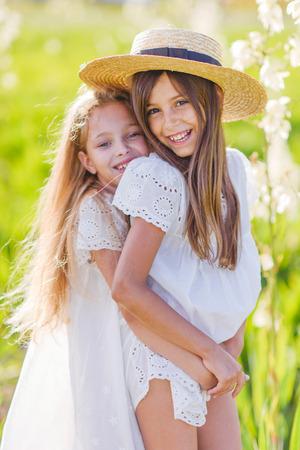 Photo pour portrait of two girls of girlfriends on a summer nature - image libre de droit