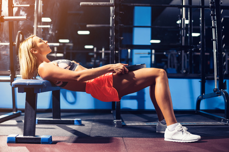 Photo for Sport girl doing exercise for abs with dumbbell in gym - Royalty Free Image