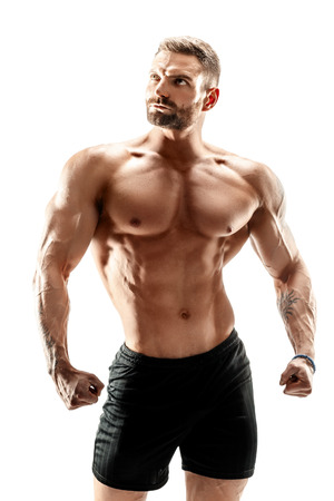 Foto de muscular super-high level handsome man posing on white background. - Imagen libre de derechos