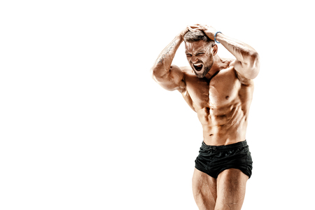 Foto de Handsome muscular shirtless man screaming while flexing his musclues isolated on white. - Imagen libre de derechos