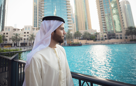 Photo for Arab young man looking to Dubai skyline - Royalty Free Image