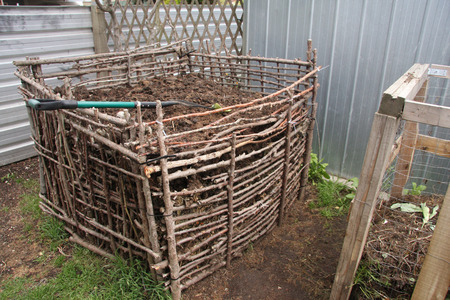 Backyard compost bin built from natural materials