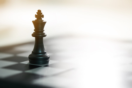 Photo for chessboard with a chess piece on the back Negotiating in business. as background business concept and strategy concept with copy space. - Royalty Free Image