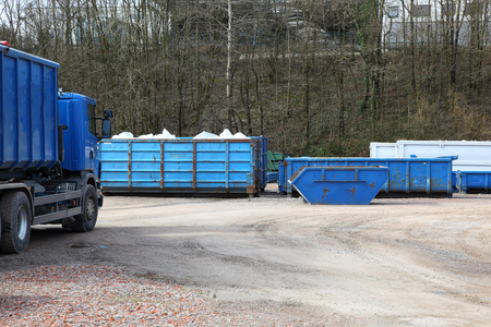 Foto de Recycling yard with trucks and containers - Imagen libre de derechos
