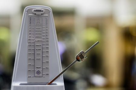 Photo pour Old fashion wood metronome music tool. Rhythm, time - image libre de droit