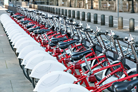 Foto de Group of bicycles in the row. Bikes for rent docking station. Selective focus. - Imagen libre de derechos