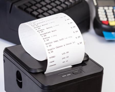 Foto de Receipt Printer with paper shopping bill. - Imagen libre de derechos