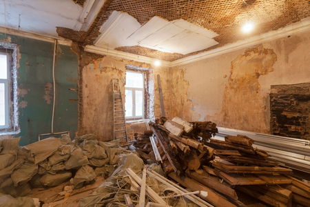 Photo for Dismantling of apartment's interior before upgrade  or  remodeling, renovation, extension, restoration, reconstruction and construction. ( sacks with construction waste and rubbish). - Royalty Free Image