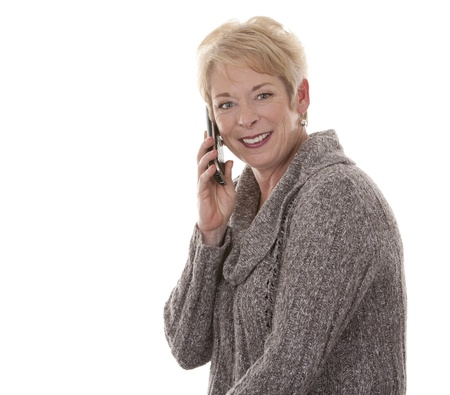 Foto für casual blond woman in her fifties using phone on white isolated background - Lizenzfreies Bild