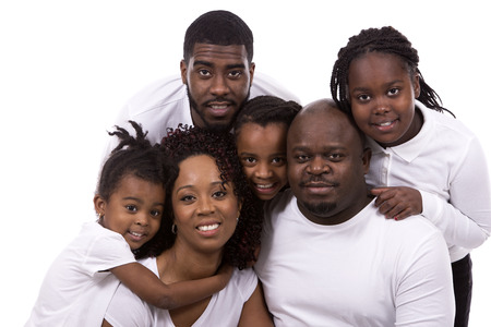 Photo pour casual young black family on white isolated background - image libre de droit