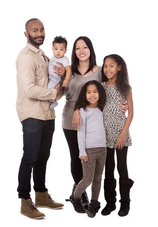 Foto de casual young mixed family on white isolated background - Imagen libre de derechos