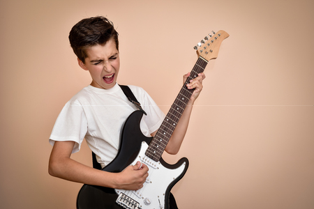 Photo for Young boy playing electric guitar - Royalty Free Image