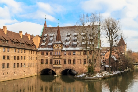Nuremberg at Christmas time, ancient medieval hospital along the river, Germany