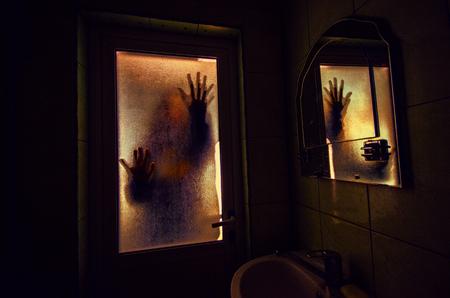Photo for Horror woman in window wood hand hold cage scary scene halloween concept - Royalty Free Image