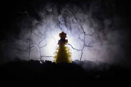Photo for Alone girl with the light in the forest at night, or toned foggy night at forest. Horror Halloween concept. Selective focus - Royalty Free Image
