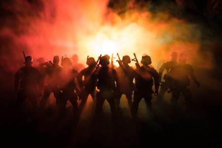 Photo pour War Concept. Military silhouettes fighting scene on war fog sky background - image libre de droit