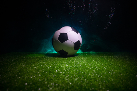 Photo pour Traditional soccer ball on soccer field. Close up view of soccer ball (football) on green grass with dark toned foggy background. Selective focus - image libre de droit