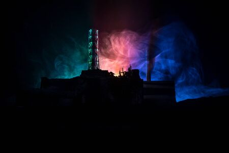 Photo for Creative artwork decoration. Chernobyl nuclear power plant at night. Layout of abandoned Chernobyl station after nuclear reactor explosion. Selective focus - Royalty Free Image
