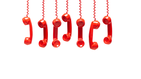 Foto de Various views of old red telephone receivers isolated on white background with texting space, hanging telephone, waiting for phone call, customer service concept, vintage telephone receiver - Imagen libre de derechos