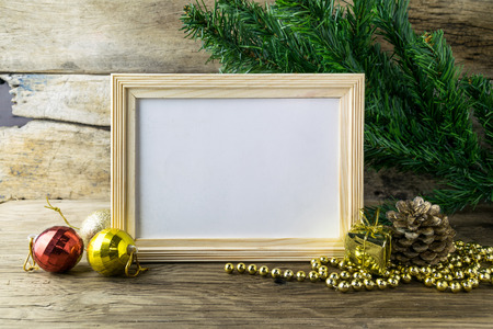Photo for Picture Frame and Christmas decorations on old wooden background. - Royalty Free Image