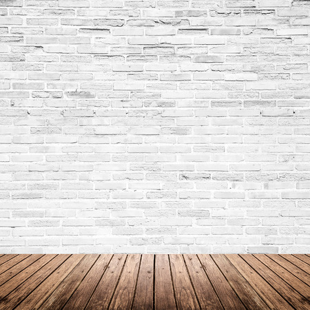 Photo pour Old interior room with broken white brick wall and grunge wood floor texture - image libre de droit