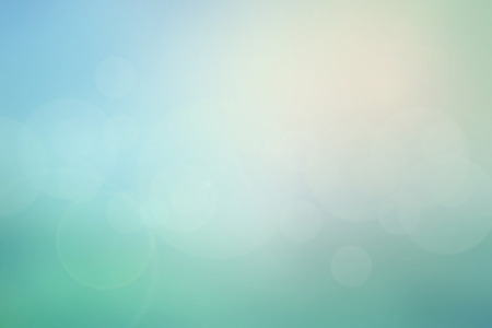 Foto de Abstract pastel sky blurred background in blue-turquoise tone with bright sunlight and flare, use for backdrop or web design in natural summer concept - Imagen libre de derechos