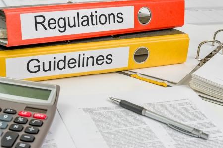 Photo pour Folders with the label Regulations and Guidelines - image libre de droit