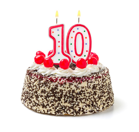 Photo pour Birthday cake with burning candle number 10 - image libre de droit