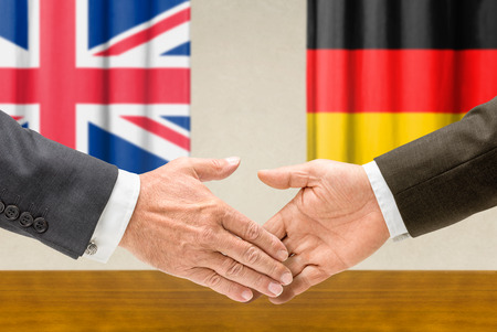 Representatives of the UK and Germany shake hands