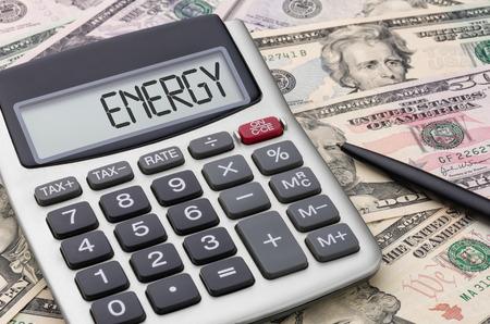 Foto de Calculator with money - Energy - Imagen libre de derechos