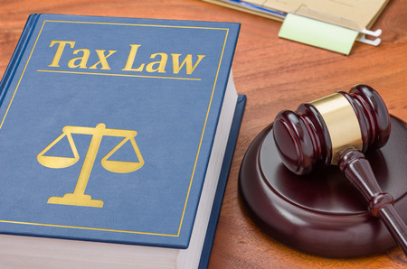 Photo pour A law book with a gavel - Tax law - image libre de droit