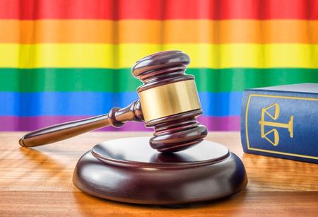 Foto de A gavel and a law book - Rainbow flag - Imagen libre de derechos