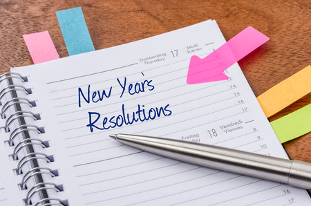 Photo pour Daily planner with the entry New Years Resolutions - image libre de droit