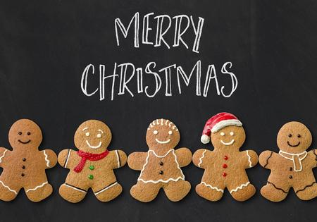 Photo pour Christmas card with gingerbread men - image libre de droit