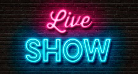 Foto de Neon sign on a brick wall - Live Show - Imagen libre de derechos