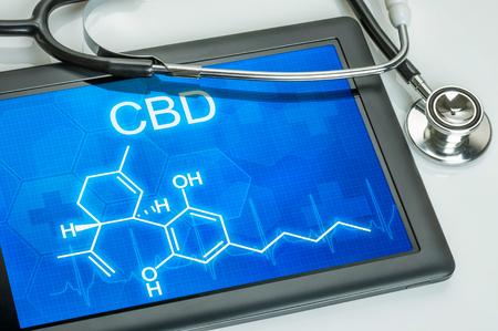 Photo pour Tablet with the chemical formula of CBD - image libre de droit