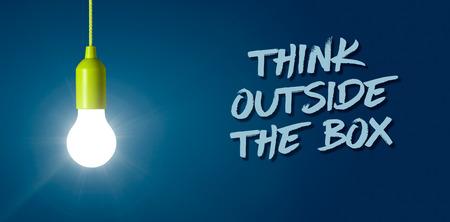 Photo pour Glowing light bulb - Think outside the box - image libre de droit