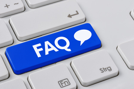 Foto de A keyboard with a blue button - FAQ - Imagen libre de derechos