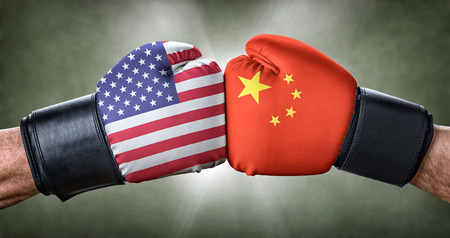 Photo pour A boxing match between the USA and China - image libre de droit