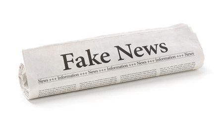 Photo for Rolled newspaper with the headline Fake News - Royalty Free Image