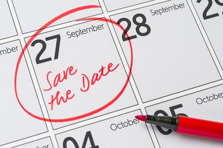 Foto de Save the Date written on a calendar - September 27 - Imagen libre de derechos